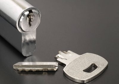 967561520-Pin-tumbler-of-cylinder-lock-internal-mechanism-and-broken-key-with-copy-space